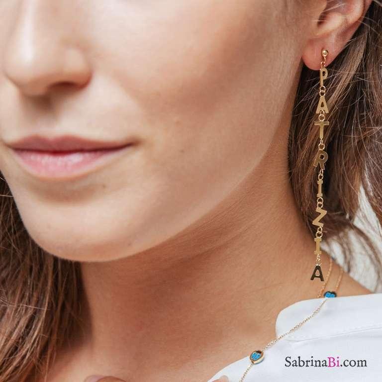 Mono orecchino oro 9K con 7 lettere pendenti